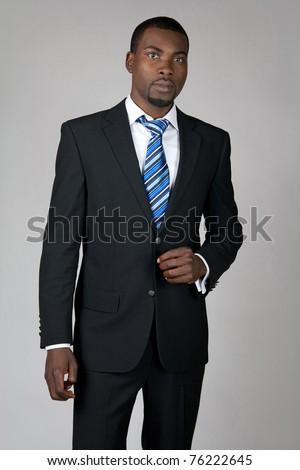 Elegant African American gentleman wearing suit and tie. - stock photo