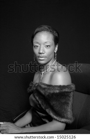 Elegant African American woman in a fur, in black and white - stock photo