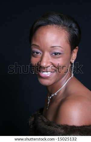 Elegant African american woman, smiling broadly with joy - stock photo