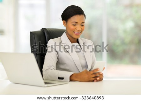 elegant african businesswoman using smart phone in modern office