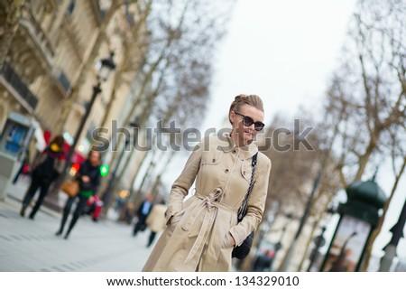Elegant and beautiful Parisian girl outdoors - stock photo