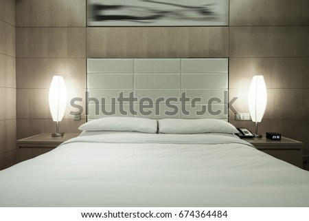 Elegant and night sense comfortable home & hotel bedroom interior.