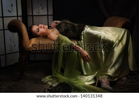 Elegant aristocratic lady in a luxurious boudoir