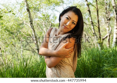 Elegant asian woman in the forest