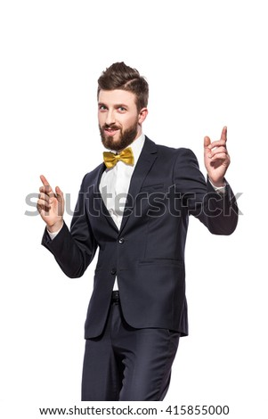 elegant bearded man in suit, bow tie with thumb up - stock photo