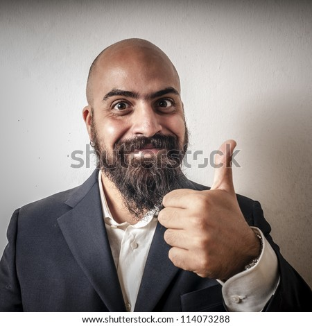 elegant bearded man with jacket and funny expressions on white background