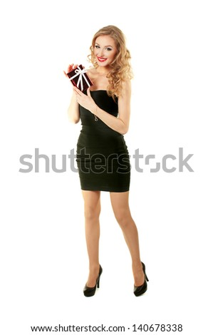 Elegant beautiful girl standing with  gift in black dress - stock photo