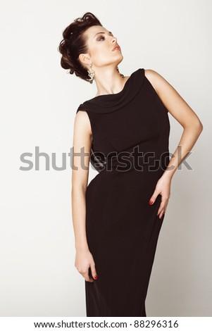 Elegant, beautiful woman in a black dress - stock photo