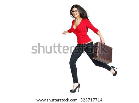 Elegant beautiful woman tourist runs with suitcase