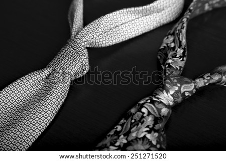 Elegant black and white Tie on table. - stock photo