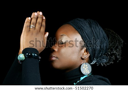 elegant black woman praying - stock photo
