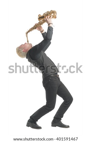 Elegant blond man dressed in black, playing the saxophone. Isolated