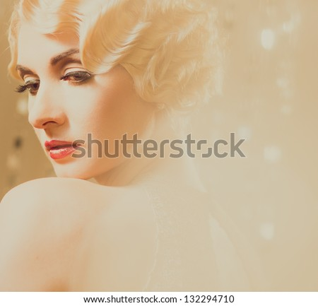 Elegant blond retro woman  in golden dress with beautiful hairdo and red lipstick - stock photo