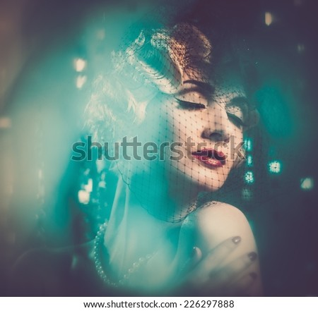 Elegant blond retro woman in veil with beautiful hairdo  - stock photo