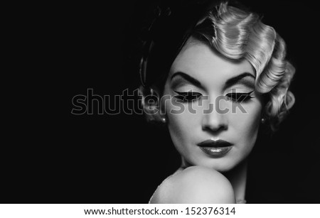 Elegant blond retro woman  wearing little hat with beautiful hairdo and red lipstick - stock photo