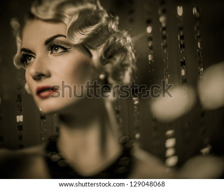Elegant blond retro woman with beautiful hairdo and red lipstick - stock photo