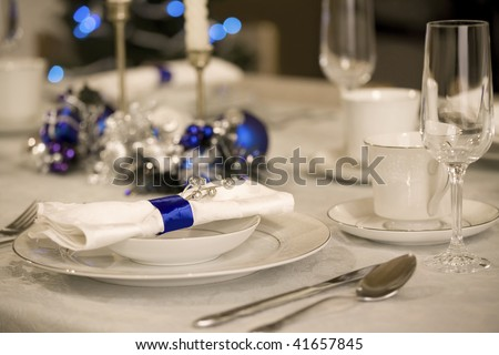 Elegant blue and white Christmas table setting - stock photo