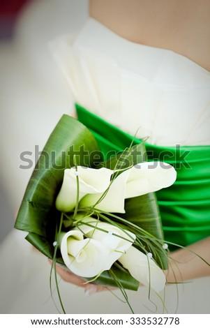 Elegant bridal bouquet of white callas - stock photo