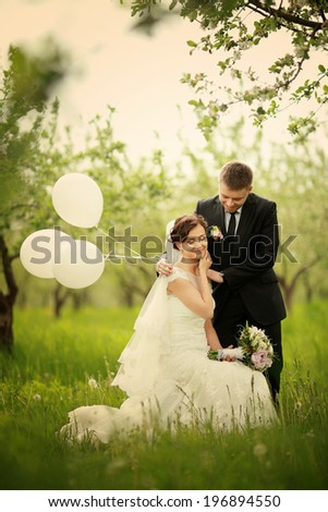 Elegant bride and groom posing together outdoors on a wedding da