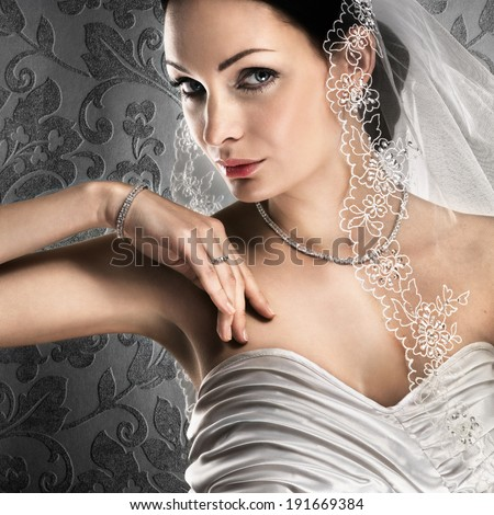 Elegant bride with diamond jewellery on vintage background  - stock photo