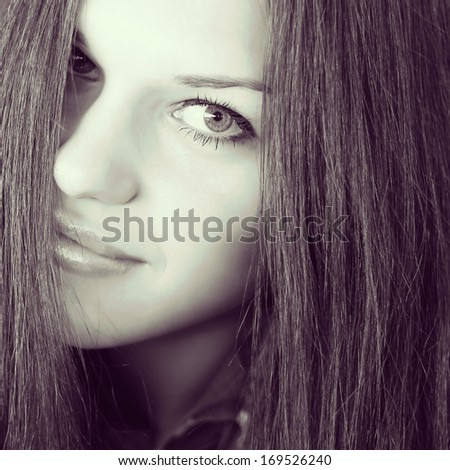 Elegant brunette woman with long hair. Black and white photo - stock photo