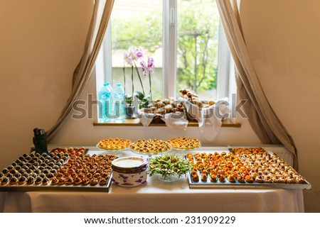 Elegant buffet table setting with canapes & Elegant Buffet Table Setting Canapes Stock Photo (Download Now ...
