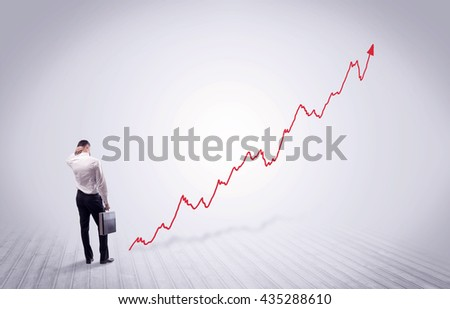 Elegant business person standing with his back looking at growing graph chart in space concept