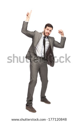 elegant businessman holdind something with one finger and showing his muscle on white