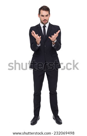 Elegant businessman in suit gesturing on white background