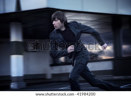 Elegant businessman running