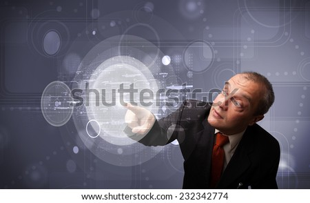 Elegant businessman touching abstract high technology circular buttons - stock photo