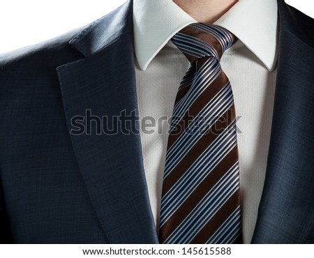 Elegant businessman wearing formal suit and tie - stock photo