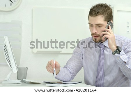 Elegant businessman with computer