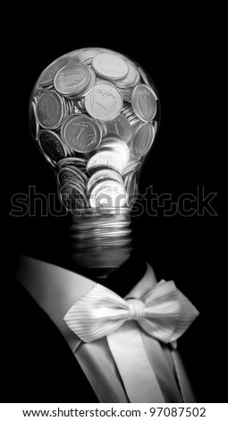 Elegant  businessman with head made by glass bulb full of silver coin