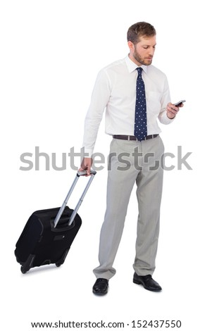 Elegant businessman with phone and suitcase against white background - stock photo