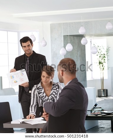 Elegant businesspeople working together, having meeting.