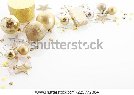 Elegant Christmas corner border with golden gifts, baubles, stars in a decorative arrangement over white with copyspace for your seasonal greeting