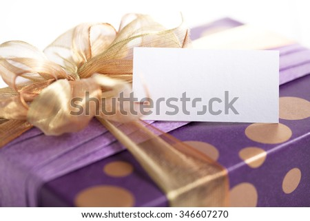 Elegant Christmas present with ribbon and blank gift card. - stock photo