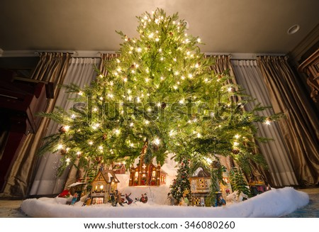 elegant christmas tree with model village - Elegant Christmas Trees