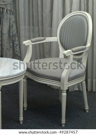 Elegant classical chair and marble table