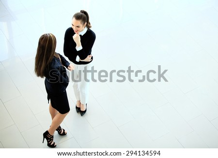 Elegant colleagues communicating at meeting - stock photo