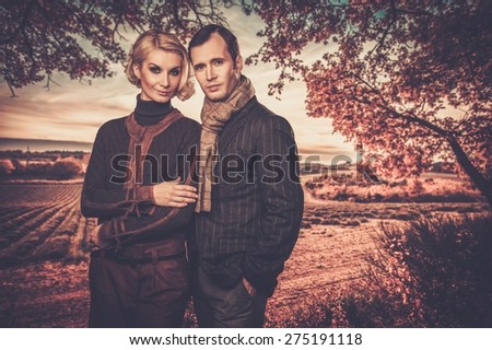 Elegant couple against lavender field - stock photo