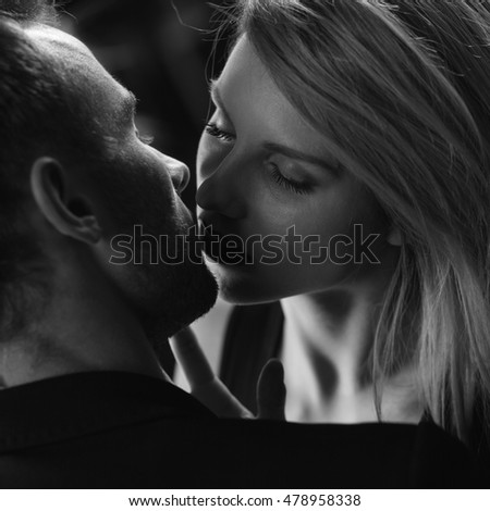 Elegant couple having a romantic kiss on a date