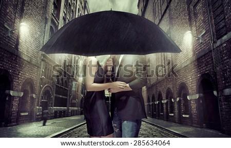 Elegant couple on rainy evening - stock photo