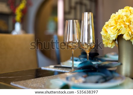 elegant crockery on dining table in modern dining room