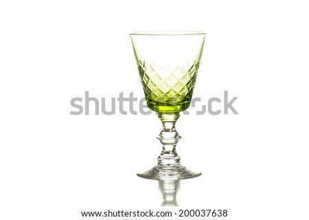 Elegant crystal green tinted goblet or wineglass on a decorative stem with a diamond pattern in the glass  with copy space, horizontal format - stock photo