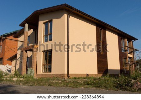 Elegant Design of Unfinished Architectural Building Construction at the Real Estate on Blue Sky Background. - stock photo