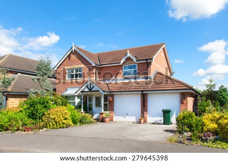 Elegant detached house with double garage - stock photo