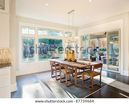 Elegant Dining Room in New Luxury Home - stock photo