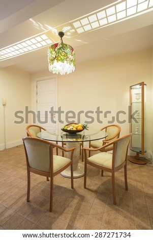 Elegant dining room interior with circular table